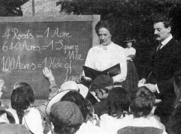 Kitty and Tom Higdon teaching on the green (from the Burston Rebellion)