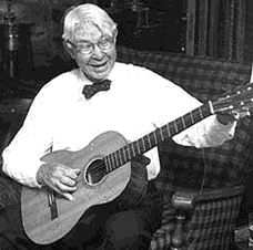 Carl Sandburg playing the guitar