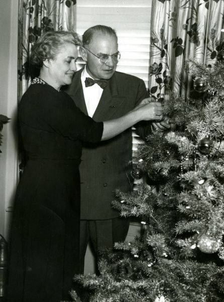 President and Mrs. Edman decorate the tree, 1954.